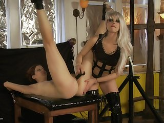 Leathered up blondie uses a dildo and a vibrator in BDSM action