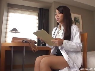 Long haired fit Japanese doctor wipes cum off her face in the office
