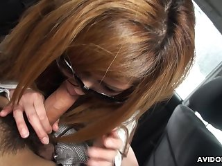 Young Japanese girl Emiko Shinoda enjoys remote control vibrator and gives a BJ in the car
