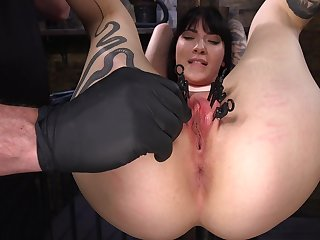 Charlotte is bound with chains and is at the mercy of her horny master