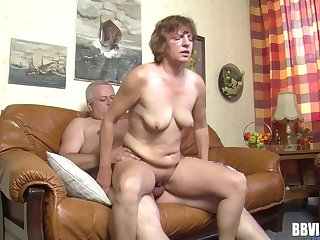 Fat dude with a small dick fucks a dirty mature slut on the sofa