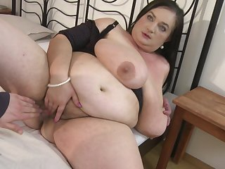 Fat old lady Stefanka C. uses her mouth to make his cock disappear