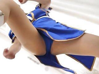 Busty costumed Japanese bombshell Shibuya Kaho gives a titjob