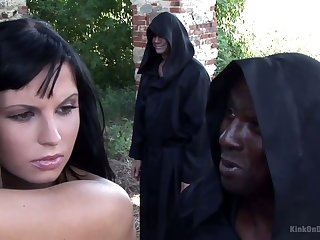 Some horny monks tie up all naked Renata to the tree outdoors